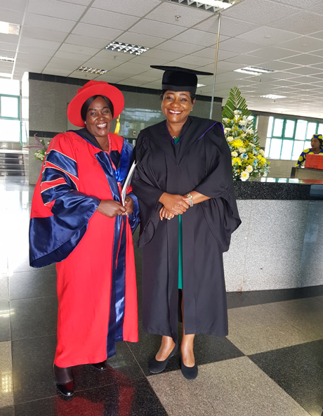Professor E. Ndove with Assistant Commissioner Charamba